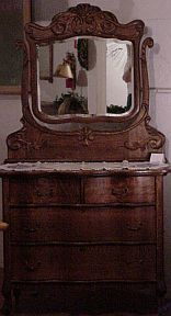 antique oak dresser with applied carving and beveled mirror