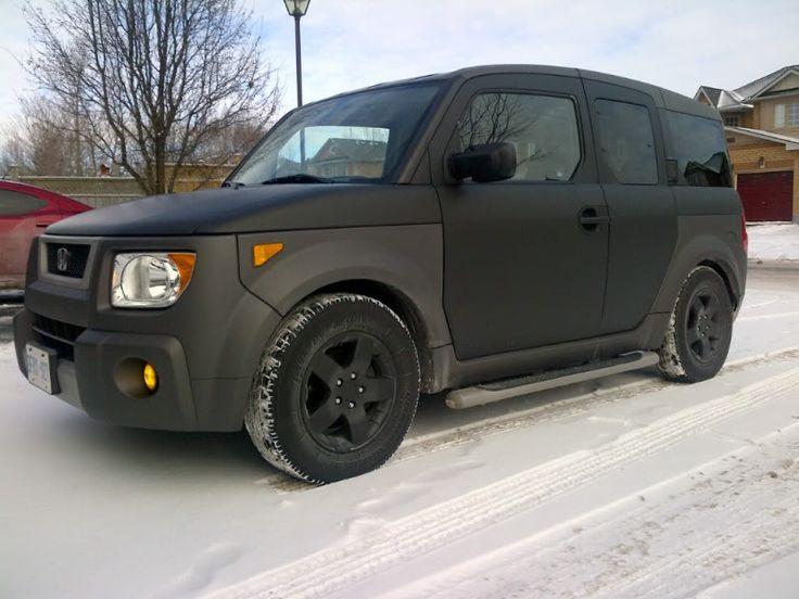 Honda Element with a flat black paint job