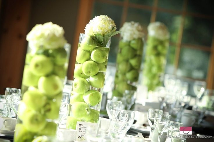 Fresh fruit, like these green apples, are a modern style that proves you don't need to spend thousands on centerpiece florals to make a statement.