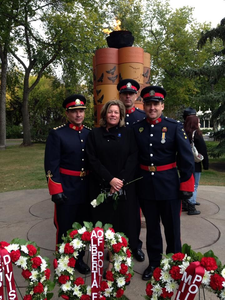 Current and former Board Directors with the John Petropoulos Memorial Fund attend the 2013 Police & Peace Officers' Memorial Day ceremony in Edmonton. From left to right: Cliff O'Brien, Maryanne Pope, Joel Matthews and Glenn Laird.