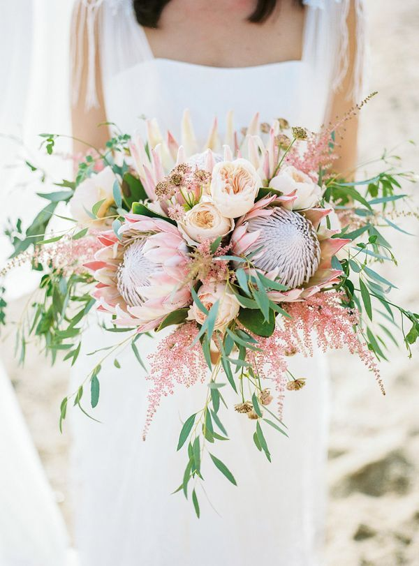 protea bouquet - photo by Charlotte van den Berg http://ruffledblog.com/spanish-bohemian-beach-inspiration