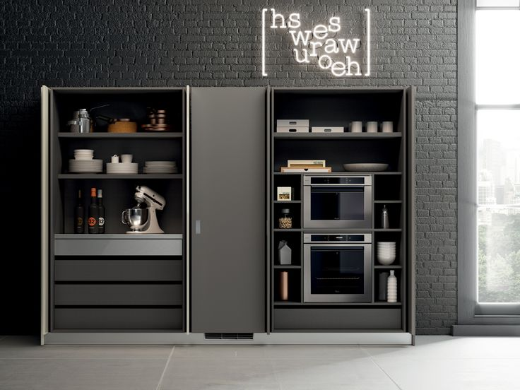The Switch cupboard meets the storage and multi-functional requirements of the kitchen. Inside, it is fitted with a pull-out steel or veneered or laminate worktop and it can house the essential household appliances in the work space. The cupboard is also fitted with side LEDs and steel or decorative melamine shelves.