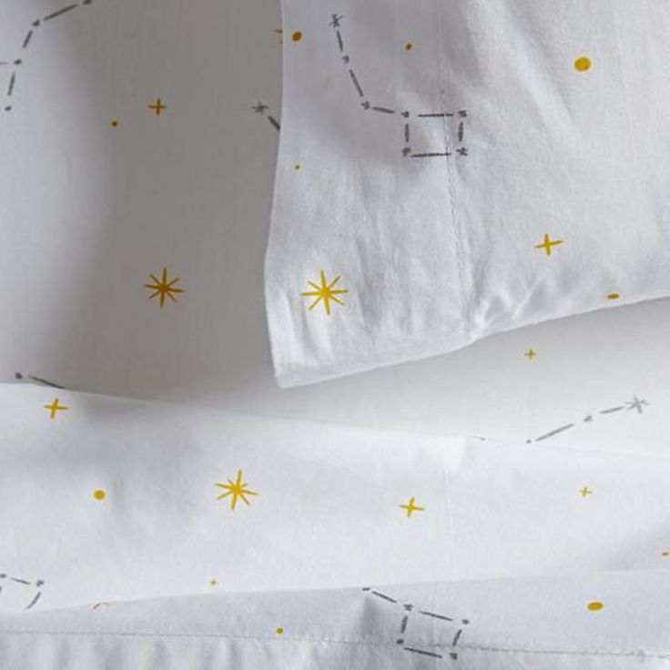 Gray and Gold Constellation Crib Bedding from The Land of Nod