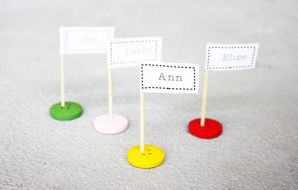 Having guests? Make cute table name flags from buttons and a toothpicks!