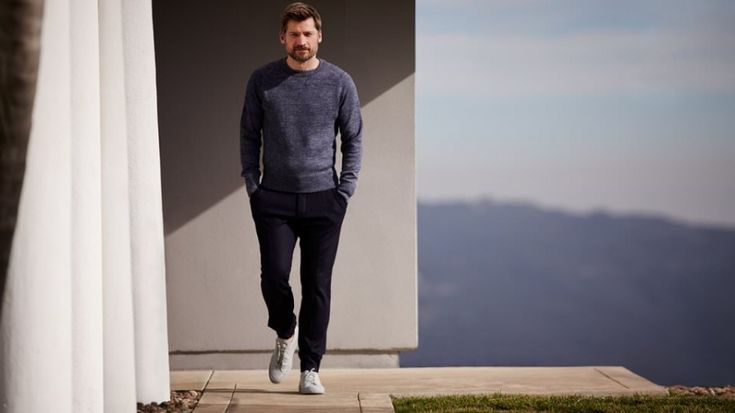 Nikolaj Coster-Waldau wears sweatshirt Tom Ford, trousers Berluti and sneakers Common Projects.