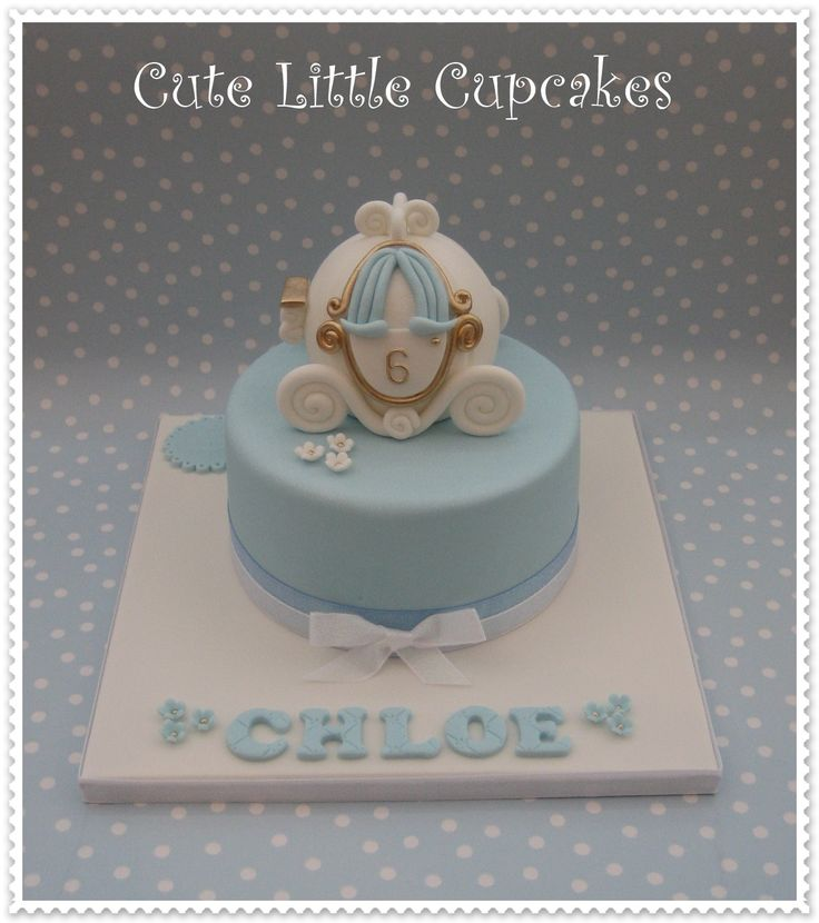 """6"""" Classic Chocolate cake decorated in pale blue & white, topped with a Rice Krispie Treat Cinderella carriage x"""