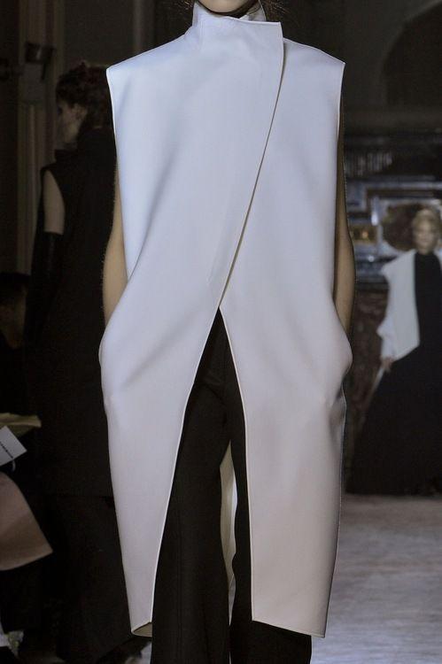 Long white sleeveless jacket; sleek minimal fashion details // Gareth Pugh A/W 2013