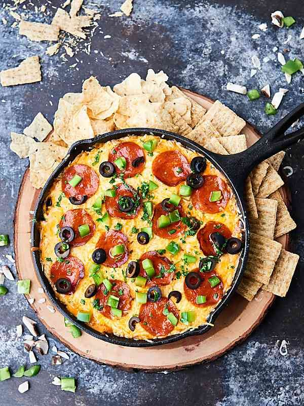 This Loaded Pizza Dip is like supreme pizza in dip form! A cream cheese base topped with sausage, veggies, pizza sauce, pepperoni, and loads of cheese! Easy game day appetizer or snack! showmetheyummy.com