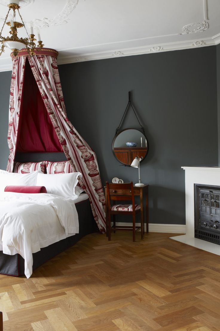 Scheme 17 - Bedroom with parquet flooring and wall painted in Down Pipe from Farrow & Ball. Image from 'Decorating with Colour'.