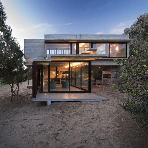 Beach house built into sand dune