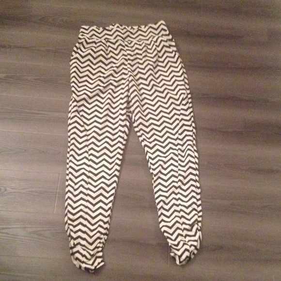 Ivory/black chevron pants Super cute chevron pants. Never worn. Cinched design at the bottom of the pants so it's not baggy. Elastic waist. Two pockets in the back and two in the front. Pants