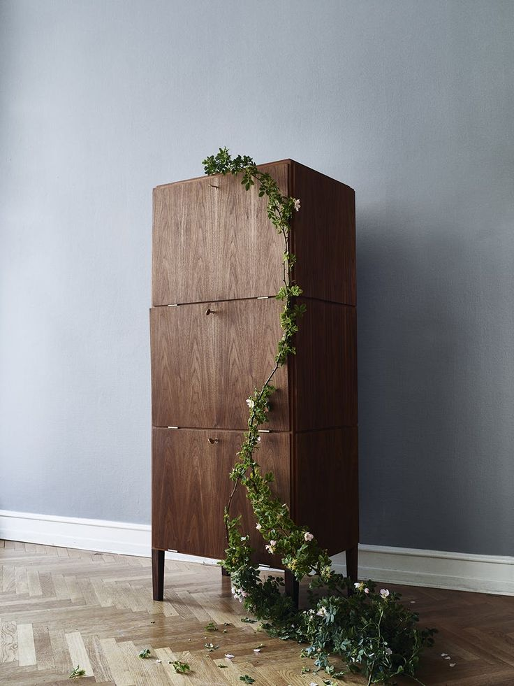 A beautiful cabinet designed by Poul Henningsen/PH in walnut. The doors can be folded down to open the shelves of the cabinet.