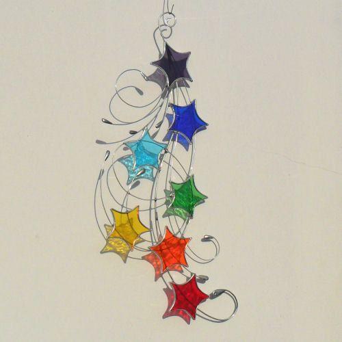 Chakra Stained Glass Suncatcher, Stars & Swirls Design. £25.00, via Etsy.