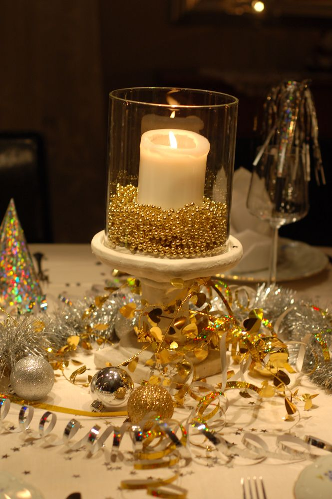 New Years Eve Decor- love the beads around the candle and all the bling.