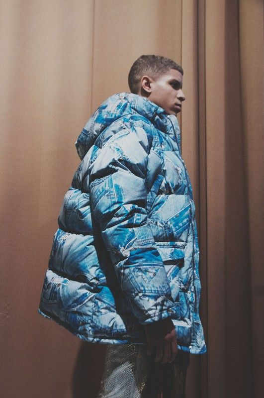 Denim print puffa jacket backstage at Moschino Mens AW15 LCM. See more here: http://www.dazeddigital.com/fashion/article/23125/1/moschino-aw15-livestream
