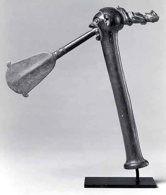Ceremonial Axe (Khaandu) Date: 19th–20th century Geography: Democratic Republic of the Congo Culture: Yaka peoples Medium: Iron, wood Dimensions: H. 10 3/8 x W. 2 x D. 7 1/2 in. (26.4 x 5.1 x 19.1cm)