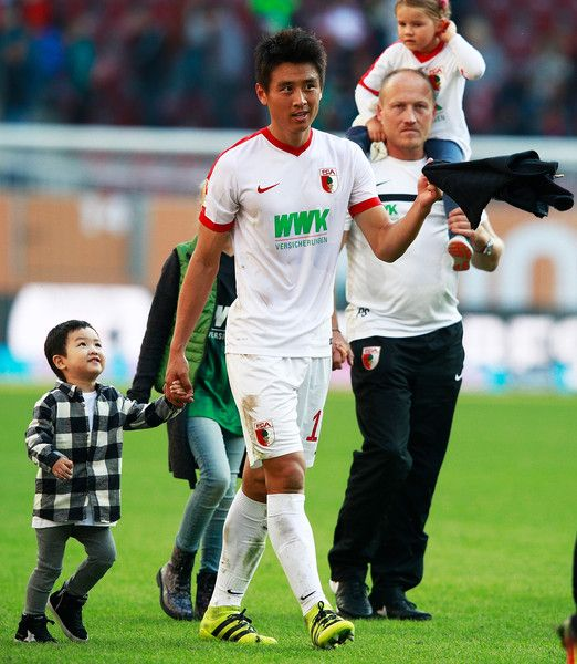 Koo Ja-Cheol of Augsburg celebrates victory after the Bundesliga match between FC Augsburg and SV Darmstadt 98 at WWK Arena on September 24, 2016 in Augsburg, Germany.