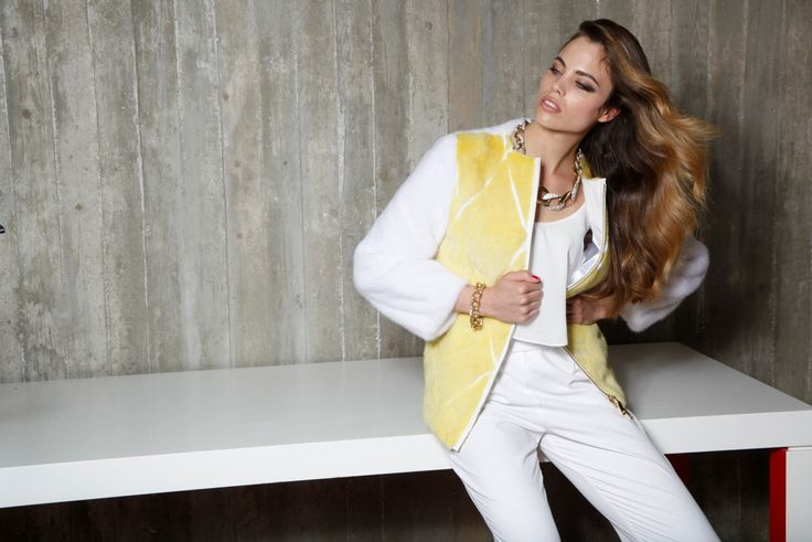 Make a fashion statement with this yellow & white mink fur jacket.