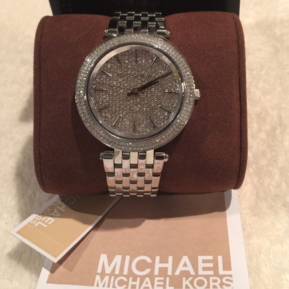 MK3437 Darci Silver Stainless Steel Women's Watch ❤️100% authentic, new with tag Michael Kors MK3437 Darci Silver Stainless Steel Women's Watch.                                                  ❤️Stainless steel bracelet Round case, 39mm, with crystal-set bezel Silver pave dial with stick indices, three hands and Michael Kors logo Quartz movement Water resistant to 50 meters MICHAEL Michael Kors Accessories Watches