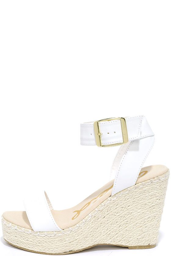 "Let the Vacation Mode White Espadrille Wedges put you in the mood for an island getaway! A 1.25"" toe platform is topped by a single toe strap, and matching, adjustable ankle strap with shiny gold buckle."