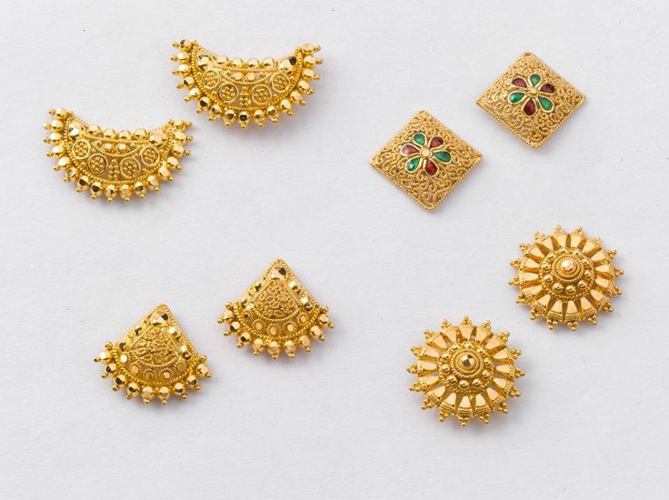 Attractive Pairs of Earrings from the gold factory  Left to right   a) 3.320 gms, Rs. 11, 300/- b) 2.850 gms, Rs. 9, 700/- c) 3.100 gms, Rs. 10, 550/- d) 3.150 gms, Rs. 10, 720/-