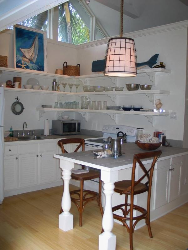 Built-In table and open shelving add a true casual feeling to this one bedroom cottage