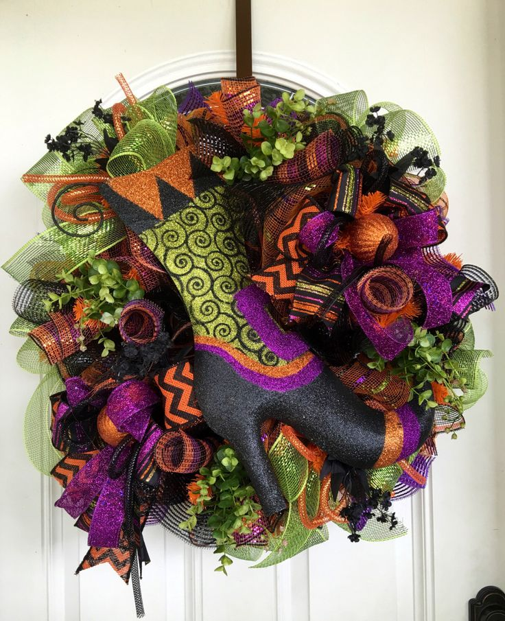 A personal favorite from my Etsy shop https://www.etsy.com/listing/385356720/halloween-wreath-witch-wreath-holiday