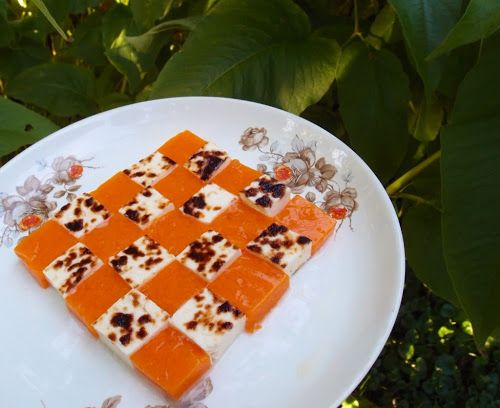 Sea-buckthorn berry jelly served with squeaky cheese