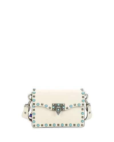 VALENTINO Rockstud Rolling Small Guitar-Strap Crossbody Bag, Light Ivory. #valentino #bags #shoulder bags #leather #crossbody #