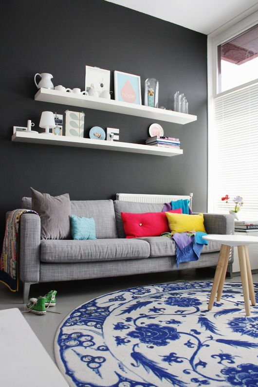 Funky Netherlands Home Tour : via Decor8 ❤ the white floating shelves on grey wall.