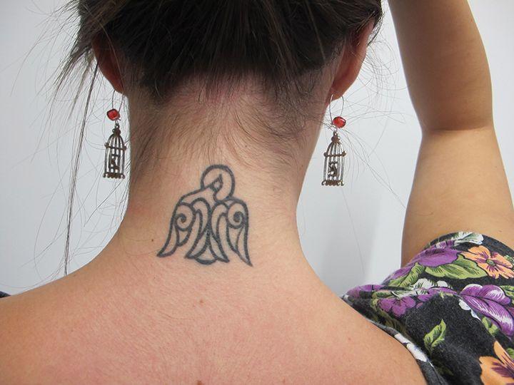 Scroll work holy spirit tattoo by Platinum Tattoo in San Antonio