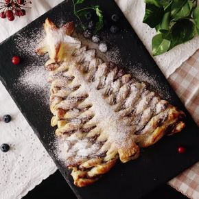 A Nutella christmas tree pie like you've never seen before! Tear off the delicious branches of chocolate-y, flakey goodness! I'm going to do raspberry jam instead of Nutella...