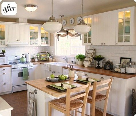 Cute vintage kitchen with subway tile and butcher block countertops