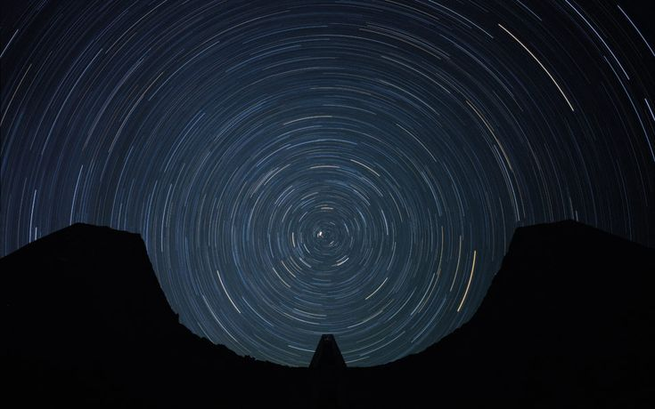 Trails left by circumpolar stars, as viewed from Star Axis, a monumental work of land art in the New Mexico desert. Photo courtesy of Charle...