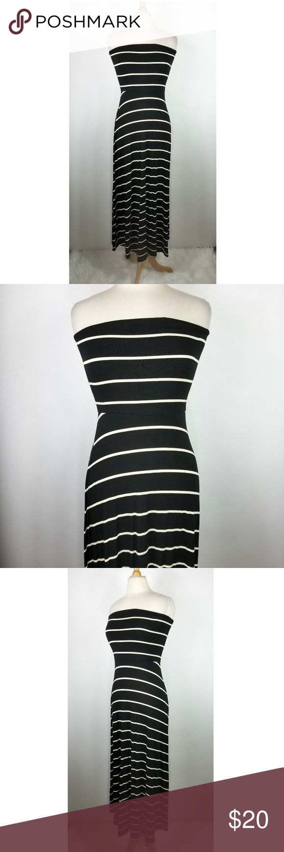 """Mudd Black White Convertible Maxi Dress Mudd women's black / white striped tube maxi dress. This can convert / roll down to be a maxi skirt. Size M. Made of 95% rayon, 5% spandex. Gently used, clean.   14"""" armpit to armpit  13"""" across at waist 51"""" long (shoulder to bottom) Mudd Dresses Maxi"""