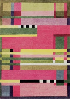OH! YES.  Gunta Stölzl was a textile master at Germany's Bauhaus school and   workshop in the early 20th century. Born in 1897, she translated modernism into weavings and vice-versa.    From the blog Material Culture.