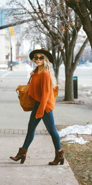#winter #fashion knitwear + orange sweater + casual denim jeans + style winter+ Cara Loren + wide brimmed fedora  Sweater: Nordstrom, Jeans: ShopBop, Shoes: Steve Madden.