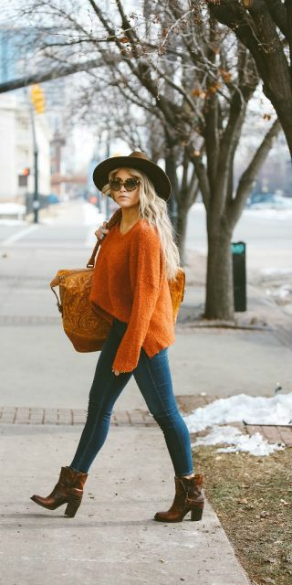#winter #fashion knitwear + orange sweater + casual denim jeans + style winter+ Cara Loren + wide brimmed fedora Sweater: Nordstrom, Jeans: ShopBop, Shoes: Steve Madden.