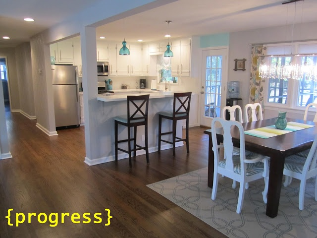 Open concept living, kitchen and dining.  Completed updated their 1950's ranch.  Retro Ranch Reno blog. Wall color:  Behr: Gentle Rain --- Kitchen blue wall:  Cool Jazz.