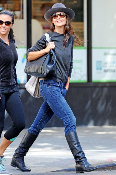 Katie Holmes looked casually chic in jeans, boots, a slouchy gray sweater, and a gray hat as she walked through New York City.