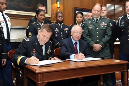 Secretary of the Interior Ken Salazar and U.S. Army Reserve Chief Lieutenant General Jeffrey Talley sign a memorandum of agreement to Increase Veteran and Reservist Job and Recreation Opportunities. Photo by Tami Heilemann.