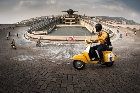 Ah, Red Bull. You sure know how to throw a party! In 2011, they held a Vespa 'race' on top of the ROOFTOP track of an old Fiat factory.