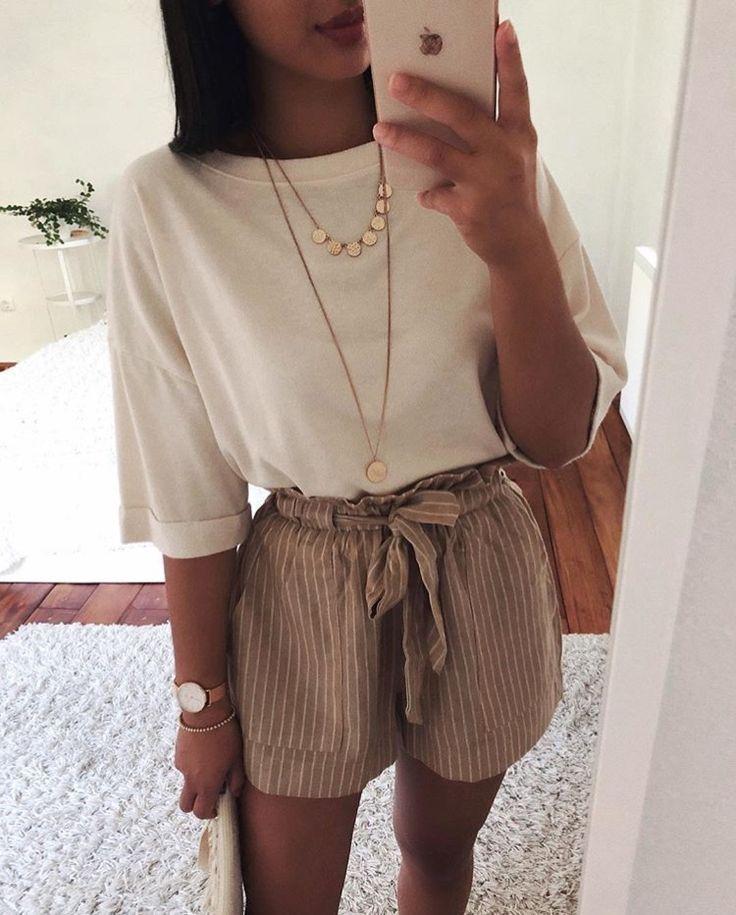 Cute shorts with white shirt and layered necklaces