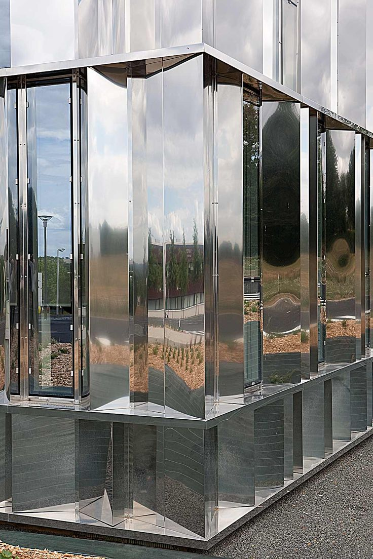 Head office of Fiteco – Facade in mirror polished stainless steel - picture ©Cécile Septet - Visit our website : www.cfa-arch.com #glass #steel #MirrorpolishedStainlessSteel #office #laval #architecture