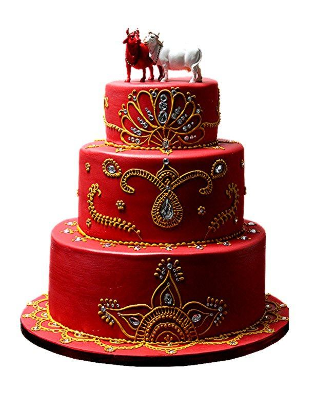 I just loved doing this cake with the cows as the topper as cows are a sacred part of the Hindu religion. The mehindhi was piped in a gold r...