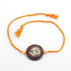 Om Rakhi Rs. 499.00 1 Om Rakhi adorned with gold plated beads. These designer Astro Rakhis are hand crafted for your dearly loved brother.  #rakhionlineindia #sendonlinerakhi #buyrakhionlineindia #sendrakhitoindia