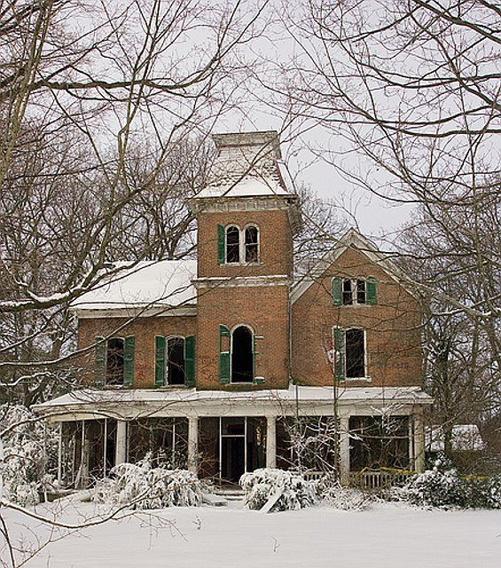 Old abandoned mansion in winter.  I can only imagine the detailed woodwork inside.  What a waste!! :((