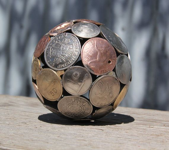 Mini mixed world coin ball Coin sphere Metal sculpture by Moerkey, $60.00 - although I'd think women would like it too :)