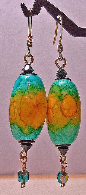 stream and yellow earrings, via Flickr. These are polymer, but I would love to be able to get this color combo and variations out of glass. With enamel powder, maybe?