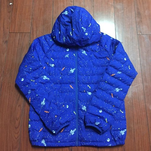 UNIQLO Jacket Cosmic pattern. Royal blue on the outside, the inside is more of a real/light blue. This is a size 12 for children but it could fit an X small or small in adult. I think it's meant for boys but it could be unisex. Never been worn.  **I can only ship out on Fridays and weekends. Sorry** UNIQLO Jackets & Coats Puffers